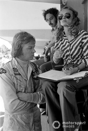 Ronnie Peterson checks his times with wife Barbro