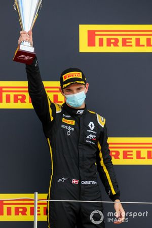 Christian Lundgaard, ART Grand Prix celebrates on the podium with the trophy