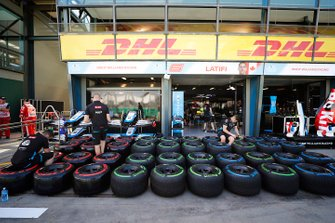 The Williams team prepare tyres in the pits
