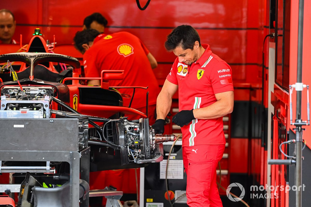 Ferrari mechnanics at work in the team's garage on a Ferrari SF1000