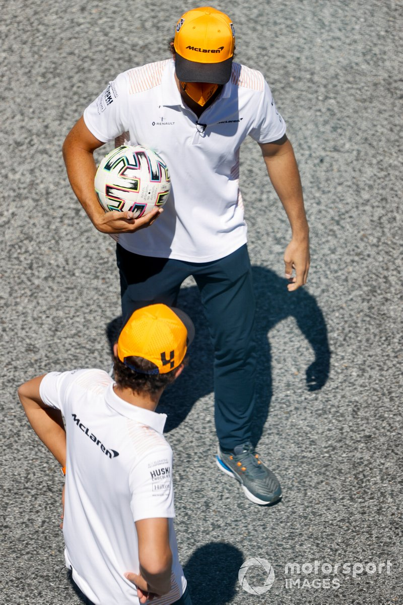 Lando Norris, McLaren and Carlos Sainz Jr., McLaren play football