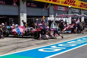 Lance Stroll, Racing Point RP20, is returned to the garage