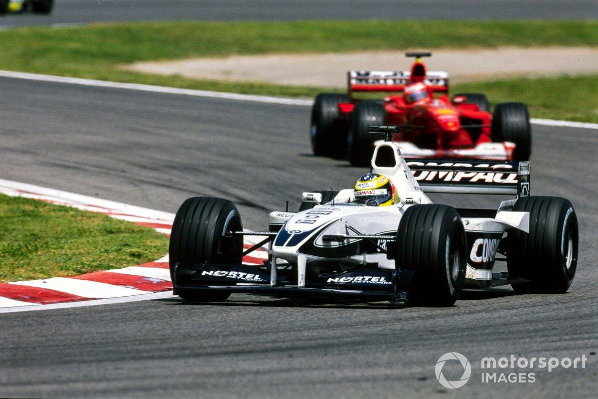 Ralf Schumacher, Williams FW22 BMW, leads Rubens Barrichello, Ferrari F1-2000