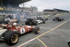 Jochen Rindt, Lotus 72-Ford, 1st position, Jack Brabham, Brabham BT33-Ford, 2nd position, and Jacky Ickx, Ferrari 312B lead at the start