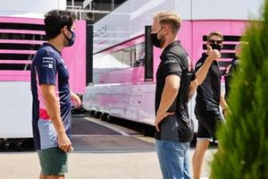 On his return to the paddock from a virus-forced absence, Sergio Perez, Racing Point, talks to Kevin Magnussen, Haas F1, as Romain Grosjean, Haas F1 gives a thumbs up