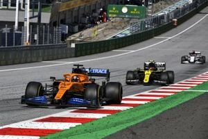 Carlos Sainz Jr., McLaren MCL35, leads Esteban Ocon, Renault F1 Team R.S.20, and Daniil Kvyat, AlphaTauri AT01