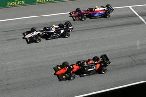 Alexander Smolyar, ART Grand Prix, leads Richard Verschoor, MP Motorsport, and Devlin DeFrancesco, Trident, at the start