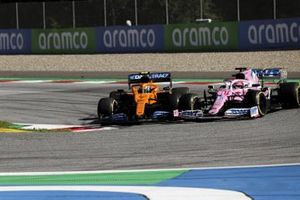 Lando Norris, McLaren MCL35, battles with Sergio Perez, Racing Point RP20