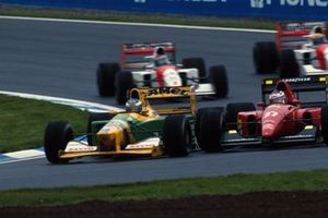 Michael Schumacher, Benetton B192 and Jean Alesi, Ferrari F92A