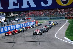 Jenson Button, BAR 006 Honda, pulls away from Michael Schumacher, Ferrari F2004, off the line at the start