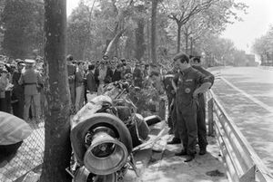 Police and Lotus mechanics guard the the wreckage of Jochen Rindt's Lotus 49B Ford