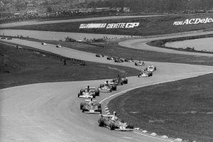Clay Regazzoni, Ferrari 312T, leads at the start of the race from team mate Niki Lauda, Ferrari 312T