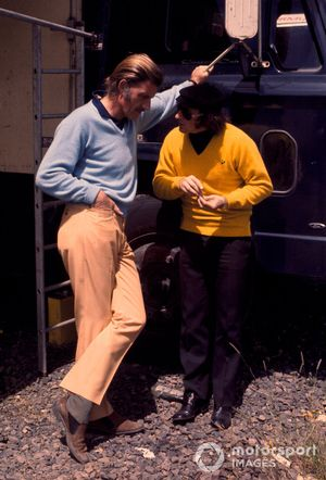Graham Hill, Lotus Ford chats with Jackie Stewart, Tyrrell