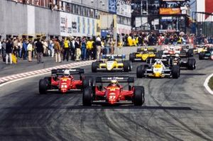 Michele Alboreto, Ferrari 126C4, leads René Arnoux, Ferrari 126C4, Keke Rosberg, Williams FW09 Honda, Derek Warwick, Renault RE50, Elio de Angelis, Lotus 95T Renault, and Manfred Winkelhock, ATS D7 BMW, at the start