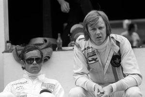 Jacky Ickx sits with his Lotus team mate, Ronnie Peterson, who finished the race in fifteenth position