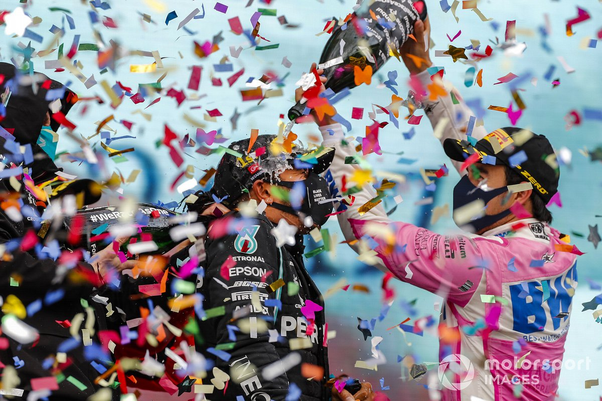 Sergio Perez, Racing Point, 2nd position, pours Champagne over Lewis Hamilton, Mercedes-AMG F1, 1st position, on the podium