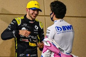 Esteban Ocon, Renault F1, 2nd position, and Lance Stroll, Racing Point, 3rd position, congratulate each other in Parc Ferme