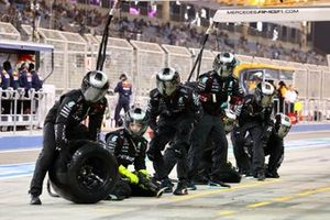 The Mercedes pit crew get ready for a stop