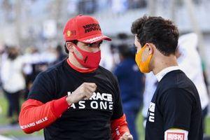 Carlos Sainz Jr., Ferrari, and Lando Norris, McLaren, on the grid