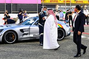 Bernd Maylander, Safety Car Driver, FIA, and Sheikh Abdullah bin Hamad bin Isa Al Khalifa, on the grid