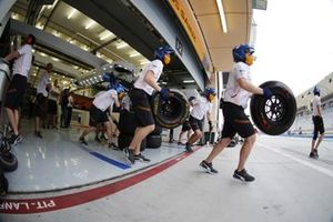 The McLaren pit crew spring into action
