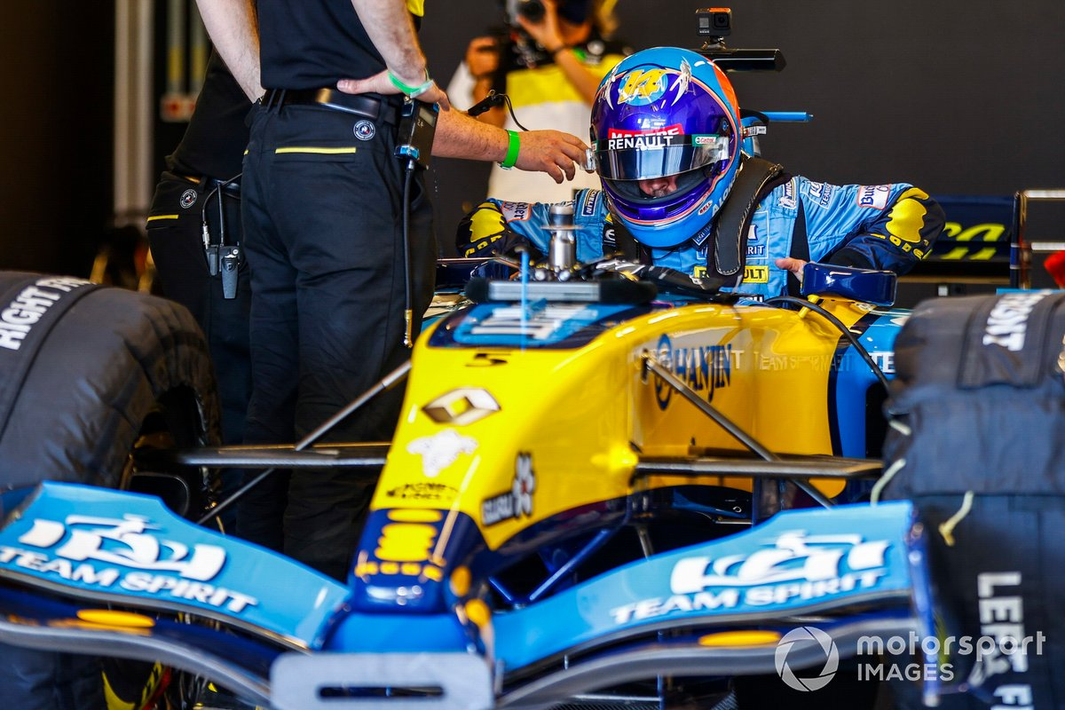 Fernando Alonso drives his 2005 Championship winning Renault R25 around the circuit