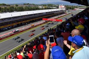 Valtteri Bottas, Mercedes AMG W10, and Lewis Hamilton, Mercedes AMG F1 W10, lead the field away at the start