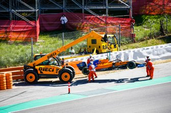 Car of Lando Norris, McLaren MCL34 being recovered by marshals