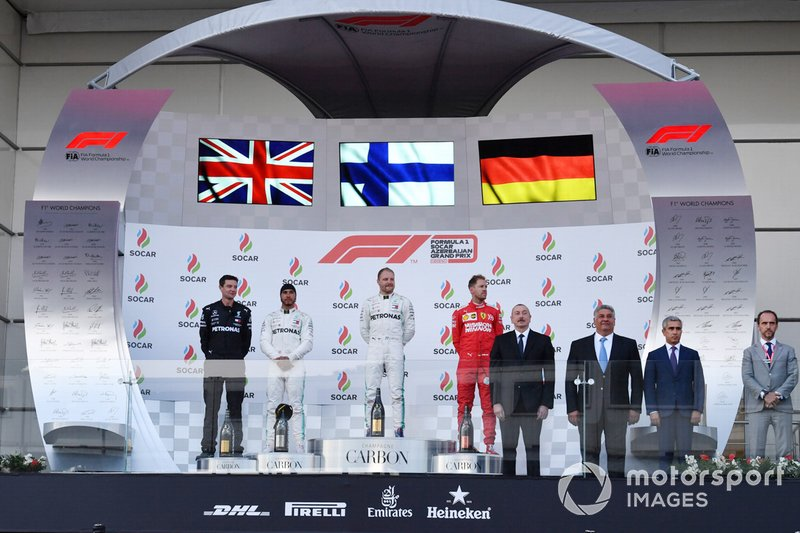 Lewis Hamilton, Mercedes AMG F1, 2nd position, Valtteri Bottas, Mercedes AMG F1, 1st position, and Sebastian Vettel, Ferrari, 3rd position, on the podium