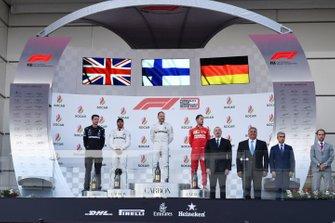 Lewis Hamilton, Mercedes AMG F1, 2nd position, Valtteri Bottas, Mercedes AMG F1, 1st position, and Sebastian Vettel, Ferrari, 3rd position, on the podium