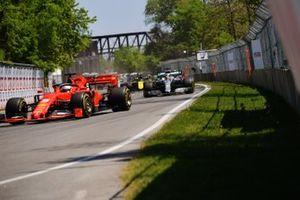 Sebastian Vettel, Ferrari SF90, leads Lewis Hamilton, Mercedes AMG F1 W10, Charles Leclerc, Ferrari SF90, Daniel Ricciardo, Renault R.S.19, Pierre Gasly, Red Bull Racing RB15, and Nico Hulkenberg, Renault R.S. 19, at the start