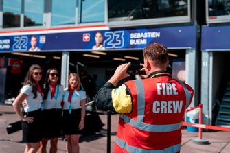 Fire crew takes a photo in the pit lane