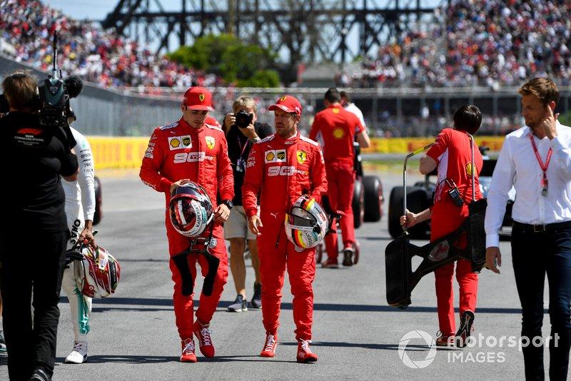 Charles Leclerc, Ferrari, talks with pole man Sebastian Vettel, Ferrari, after Qualifying