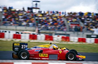 Race winner Michele Alboreto, Ferrari 156/85 overtakes Keke Rosberg, Williams Honda FW10