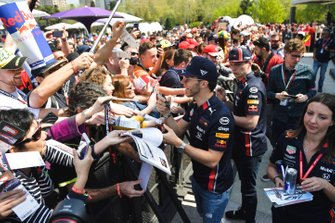 Max Verstappen, Red Bull Racing and Pierre Gasly, Red Bull Racing sign autographs for fans