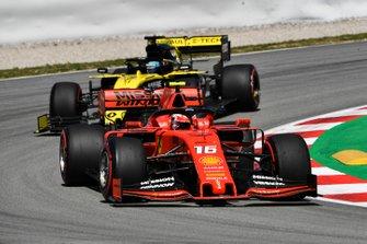 Charles Leclerc, Ferrari SF90, leads Daniel Ricciardo, Renault R.S.19