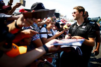Romain Grosjean, Haas F1 signs a autograph for a fan