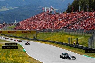 Lewis Hamilton, Mercedes AMG F1 W10, leads Kimi Raikkonen, Alfa Romeo Racing C38, and Lando Norris, McLaren MCL34