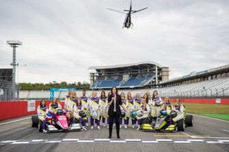 The drivers pose for a pre-season photo on the grid with Lee McKenzie