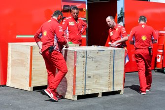Ferrari mechanics with a delivery