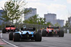 Sebastian Vettel, Ferrari SF90, leads Max Verstappen, Red Bull Racing RB15, and George Russell, Williams Racing FW42