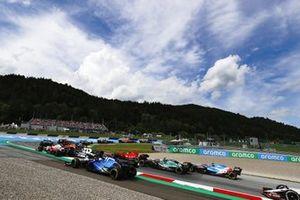 Nicholas Latifi, Williams FW43B, runs wide as Carlos Sainz Jr., Ferrari SF21, Sebastian Vettel, Aston Martin AMR21, and Esteban Ocon, Alpine A521