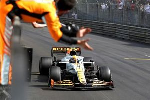 Lando Norris, McLaren MCL35M, 3rd position, crosses the line to the cheers of his team on the pit wall