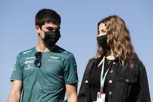 Lance Stroll, Aston Martin, arrives at the circuit with Sara Pagliaroli