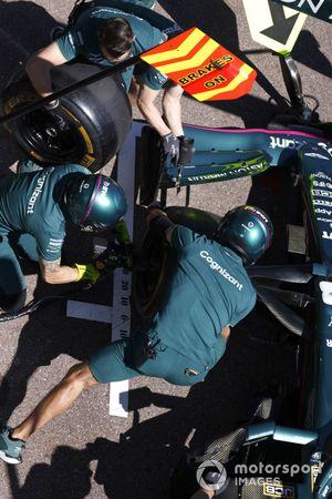 The Aston Martin team practice their pit stop drills