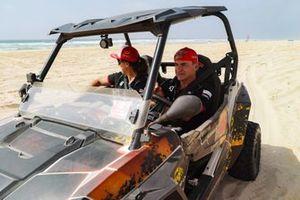 Laia Sanz, Acciona | Sainz XE Team, and Carlos Sainz, Sainz XE Team, explore the course
