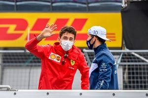 Charles Leclerc, Ferrari, and Pierre Gasly, AlphaTauri, at the drivers parade