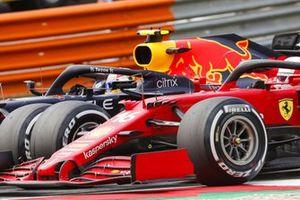 Sergio Perez, Red Bull Racing RB16B , battles with Charles Leclerc, Ferrari SF21