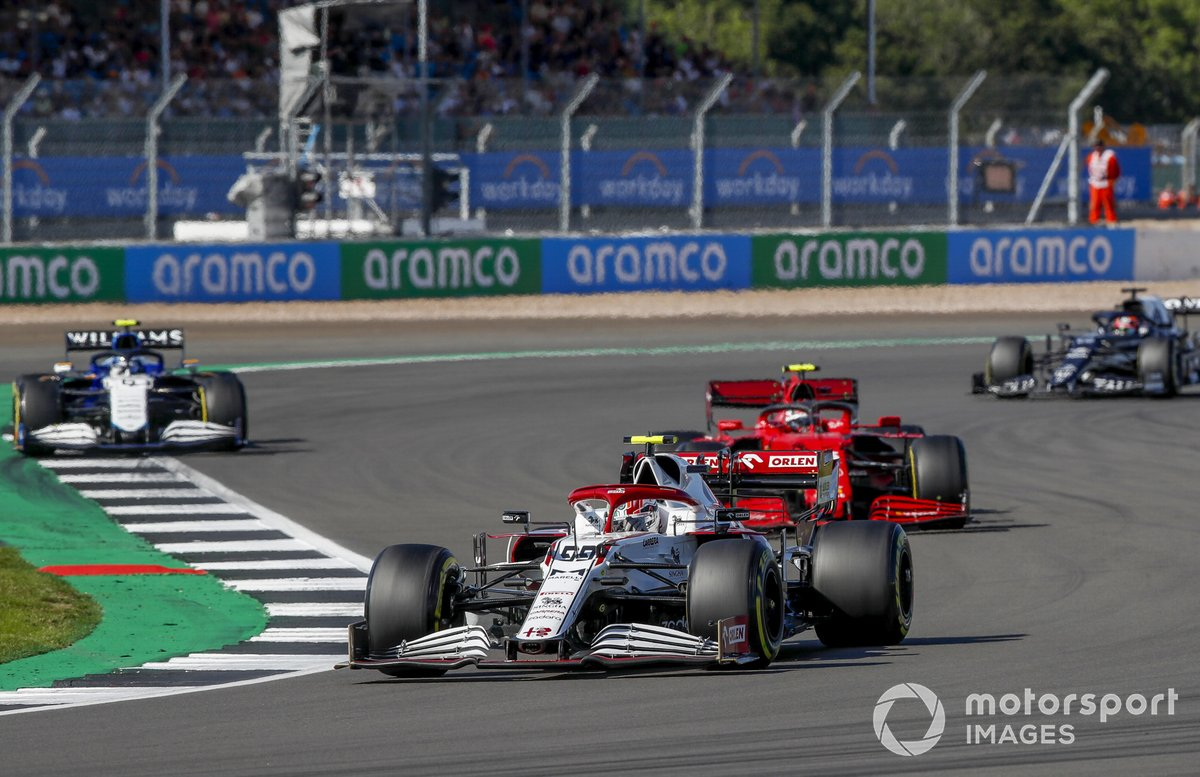 Antonio Giovinazzi, Alfa Romeo Racing C41, Carlos Sainz Jr., Ferrari SF21, and Nicholas Latifi, Williams FW43B