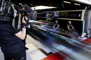 Valtteri Bottas, Mercedes W12, leaves the pit garage